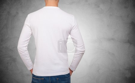 Photo for Back portrait of a man wearing a white t-shirt with long sleeves - Royalty Free Image