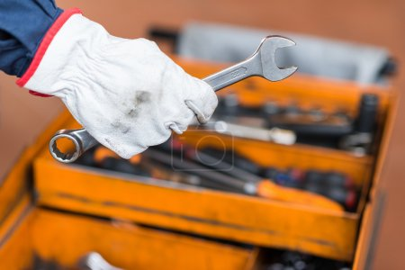 Photo for Mechanic's hand holding a wrench - Royalty Free Image