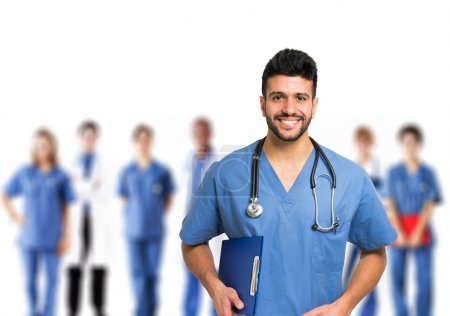 smiling doctor in front of team