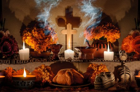 Traditional mexican Day of the dead altar with pan...