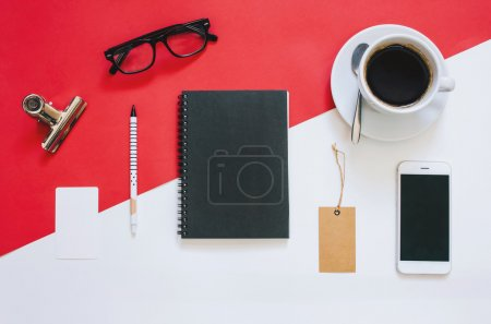 Photo for Creative flat lay photo of workspace desk with smartphone, eyeglasses, coffee, tag and notebook with copy space background, minimal style - Royalty Free Image