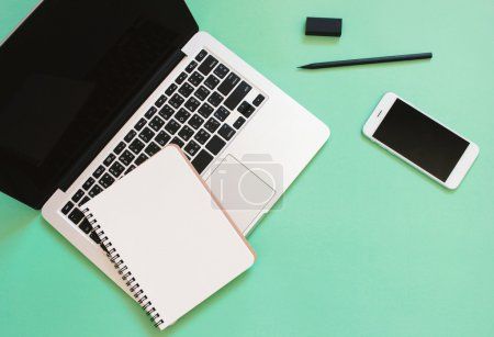 Photo for Creative  workspace desk with laptop, blank notebook, smartphone and stationery with copy space background - Royalty Free Image