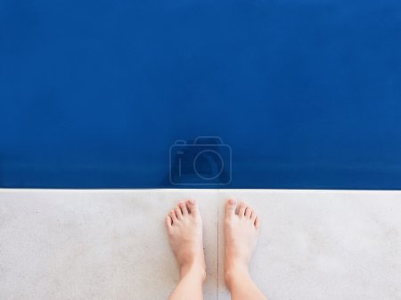 Barefoot girl in swimming pool