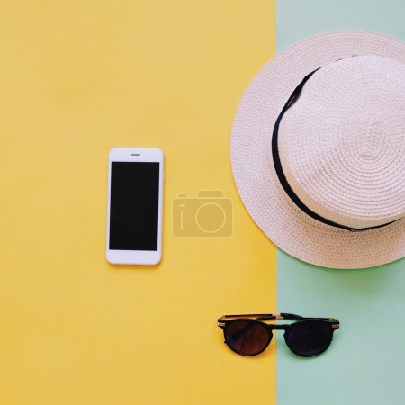 Smart phone with panama hat and sunglasses