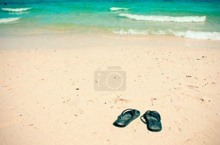 Flip flops on sandy beach