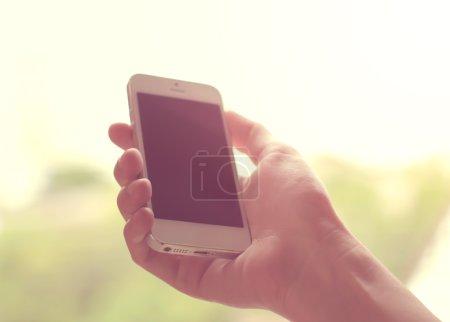Hand using smart phone