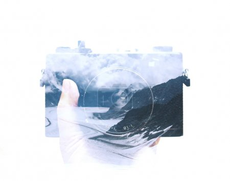 Photo for Double exposure of hand holding film camera and landscape background - Royalty Free Image