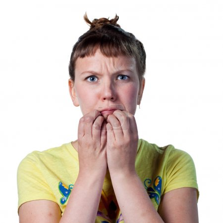 Photo for Young woman worried, with hands to her mouth - Royalty Free Image