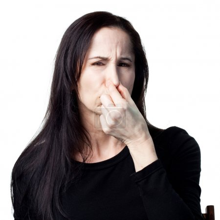 Woman covers her nose