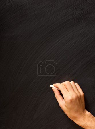 Photo for Male hand writing with chalk on a clean blackboard - add your own chalk! - Royalty Free Image