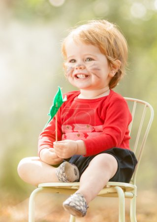 Photo for Young toddler playing outside - Royalty Free Image