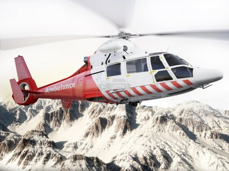 Rescue helicopter in flight over snow capped mountains with motion blur blades.