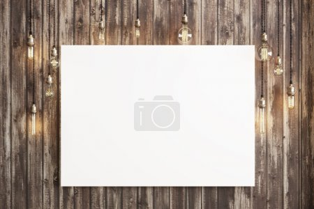 Foto de Mock up poster with ceiling lamps and a rustic wood background, Photo realistic 3d illustration. - Imagen libre de derechos