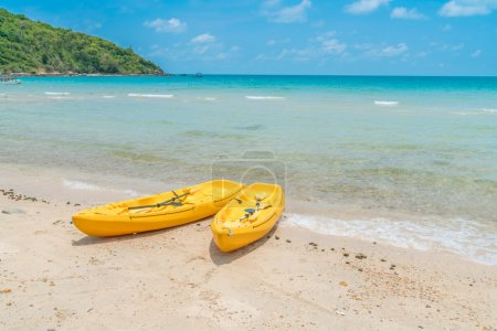 Yellow kayaks on white sand beac,High definition images