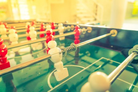 Football table game with red and white player . ( Filtered image