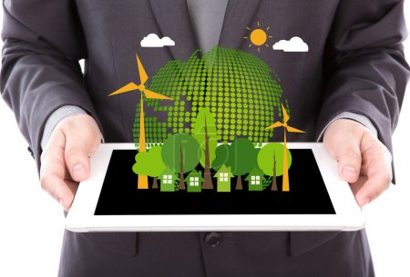 Photo for Portrait of young business man using a touch screen device with Eco friendly earth - Royalty Free Image