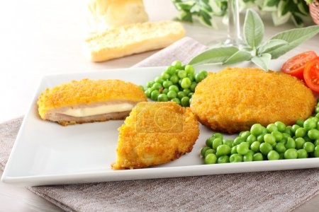 Cutlet stuffed with ham and melted cheese