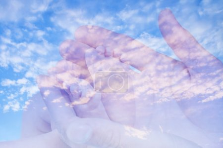 Sweet baby feet in double exposure with blue sky background