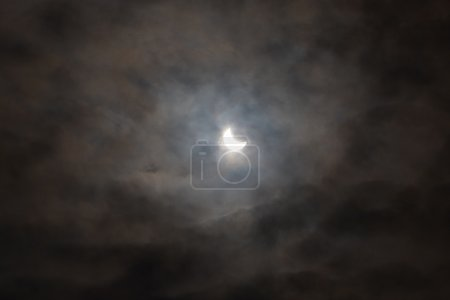 Photo for Solar eclipse with dark cloudy sky, mystery - Royalty Free Image