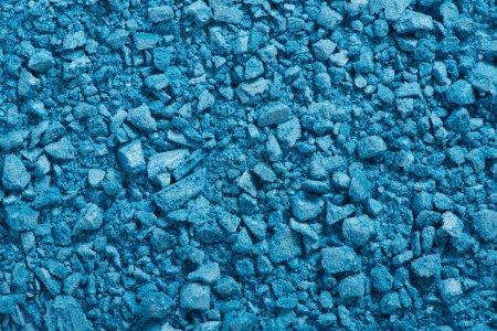 Photo pour Ombre à paupières bleue broyée, fond de texture cosmétique - image libre de droit