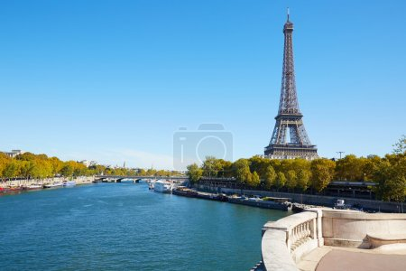 Eiffel tower and empty white balcony on Seine river in a sunny day