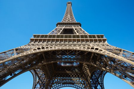 Eiffel tower, sunny summer day with blue sky in Paris