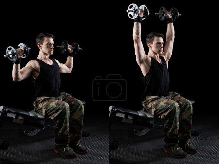 Photo for Shoulder press exercise. Studio shot over black. - Royalty Free Image