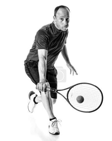 Photo for Tennis action shot. Backhand. Studio shot over white. - Royalty Free Image