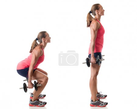 Photo for Dumbbell squat exercise. Studio shot over white. - Royalty Free Image