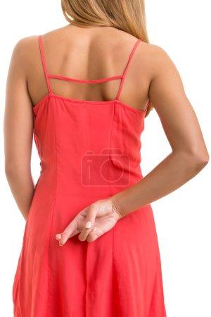 Photo pour Gros plan des doigts croisés dans le dos d'une femme - image libre de droit