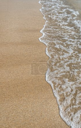 Sand and wave