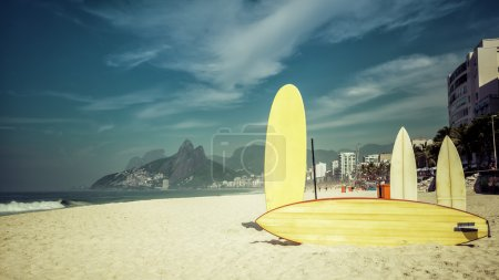 Surfboards standing on the beach