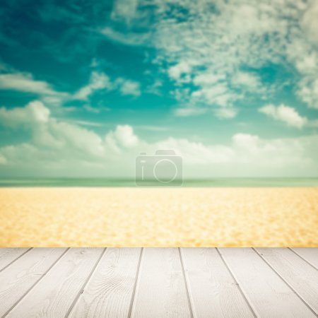 Empty blurred beach with wooden boards