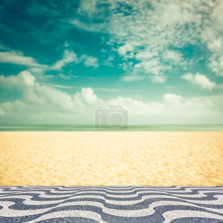 Empty blurred beach with mosaic