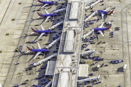 Busy Airport Terminal With Jets