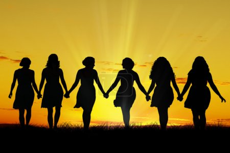 Photo pour Silhouette of six young women, walking hand in hand - image libre de droit