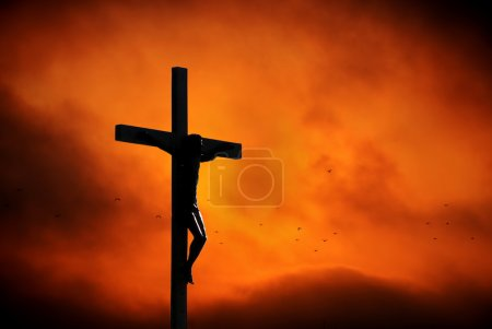 Photo for Jesus Christ on the cross over dramatic sky background - Royalty Free Image
