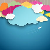 Colorful paper cut clouds shape design on blue background