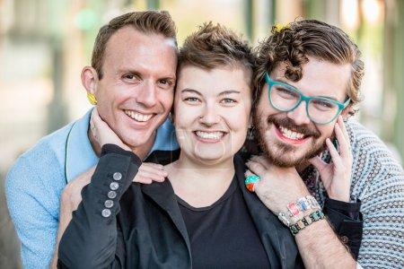 Photo pour Trois sexe fluide amis posent et sourient - image libre de droit