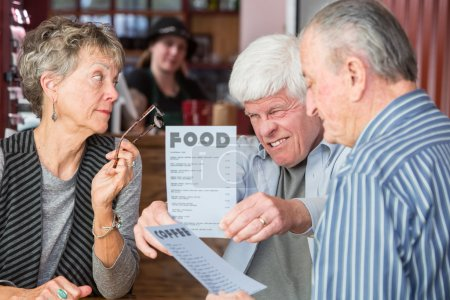 Mature Man Struggles to Read Menu Without Glasses