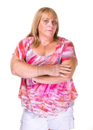 Photo pour Femme transgenre mature sceptique ou en colère sur fond blanc - image libre de droit
