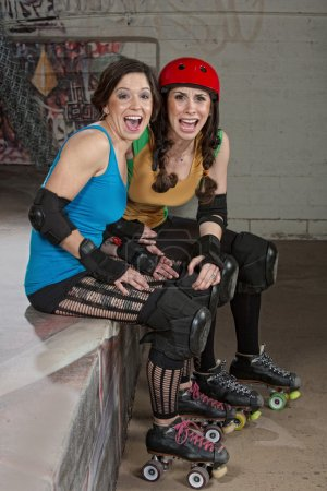 Photo for Ladies at roller derby as spectators laughing - Royalty Free Image