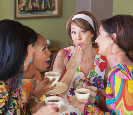 Embarrassed Woman with Friends Drinking Tea