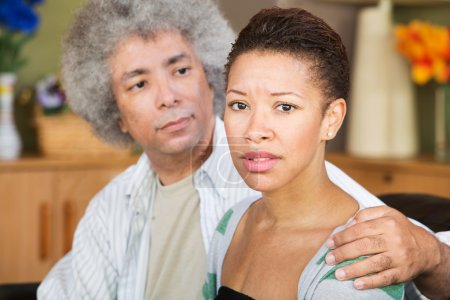 Photo for Concerned young woman with caring mature husband - Royalty Free Image