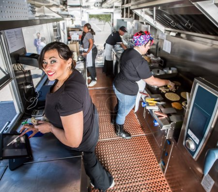 cashier with payment on busy food truck