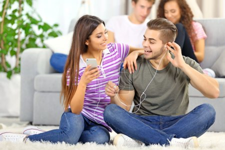 Teenager couple listening to music