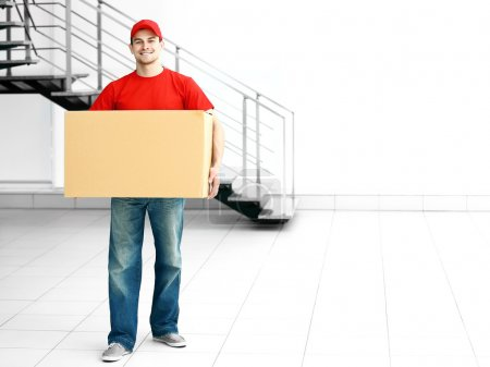 Photo for Man holding carton box in the room - Royalty Free Image