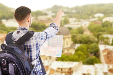 Traveler with map on cityscape