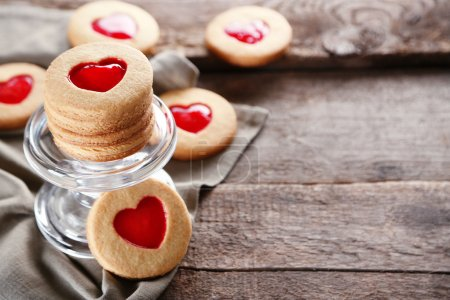 Photo for Love cookies with grey cloth on wooden background, closeup - Royalty Free Image