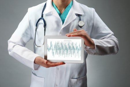 doctor holding tablet in hands